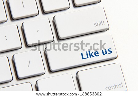 Photo of like us button on the white keyboard.