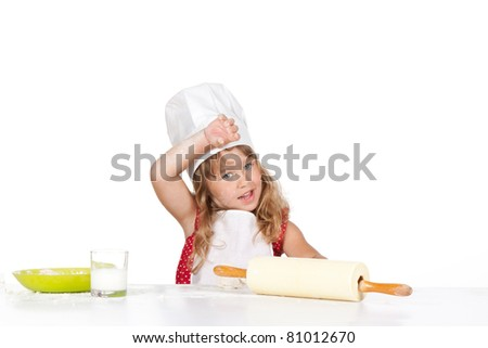 photo of little baker adorable, pretty little caucasian tired girl in chef hat, happy smile 4 year child mix dough, isolated over white background. Cooking concept. - stock photo