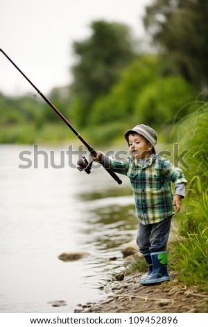 photo of little boy fishing - stock photo