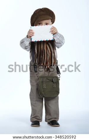 photo of little funny boy with letter in hands