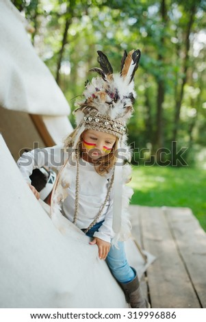 photo of little funny girl with native american costume - stock photo