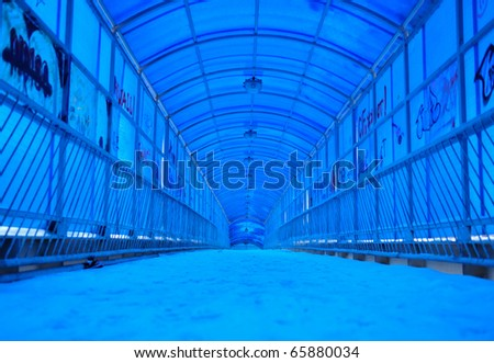 Photo of long tunnel of metal and plastic