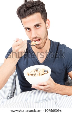 photo of man who is eating cornflakes for breakfast