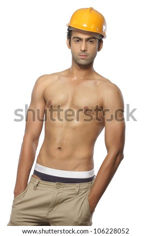photo of man with naked body wearing harhat over white background