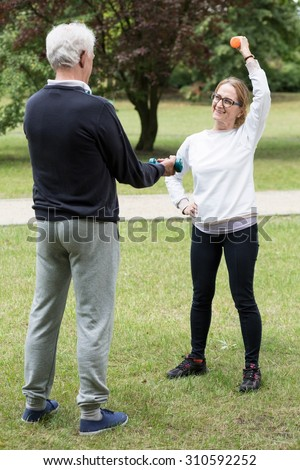 Photo of mature athletic pair during outdoor physical activity