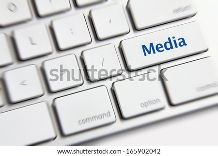 Photo of media button on the white keyboard.