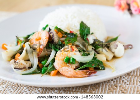 photo of mixed seafood basil with rice,delicious thai food