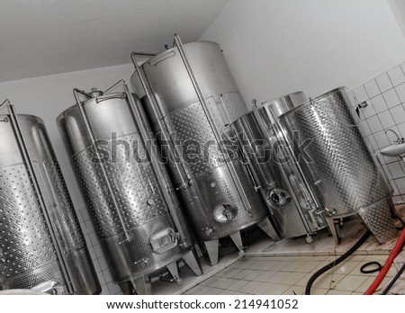 Photo of modern aluminum barrels in the winery - stock photo