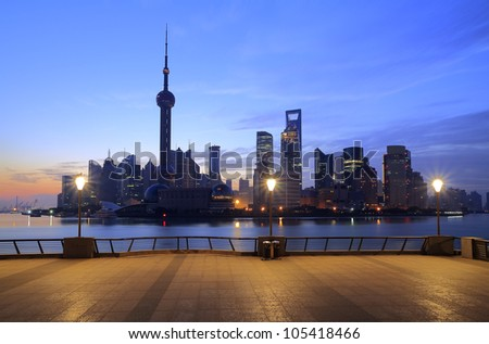 Photo of modern buildings by Huangpu river at dawn Pudong Lujiazui Skyline Shanghai, China - stock photo