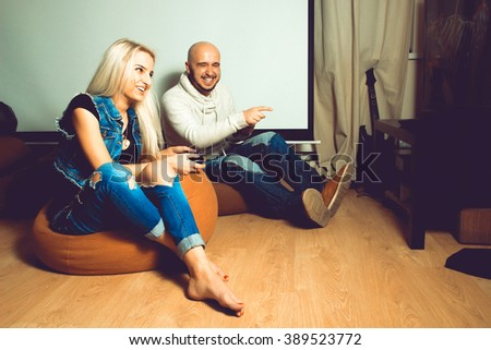 Photo of modern young couple having fun and playing computer games. concept of leisure entertainment and fun - stock photo