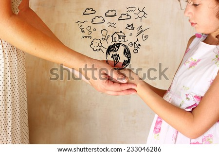 photo of mother and child holding hands and showing a better world concept with set infographics . protection and education concept - stock photo