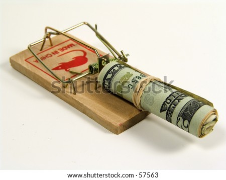 Photo of Mousetrap With Rolled Up Money
