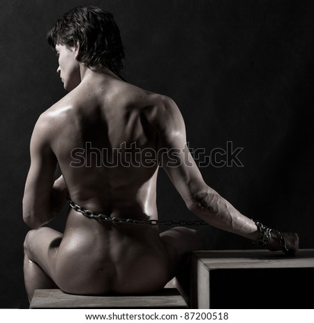 Photo of naked athlete with chain - stock photo