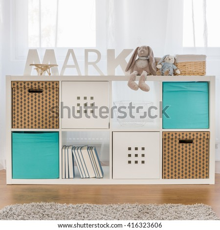 Photo of new design functional kids cube storage - stock photo