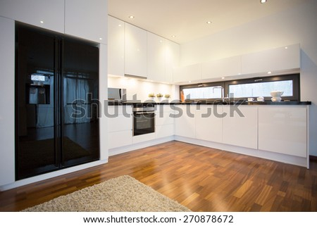 Photo of new luxury open kitchen in contemporary house - stock photo