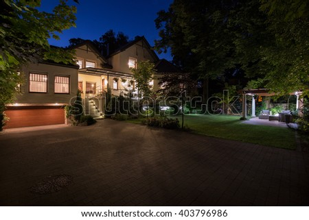 Photo of new white mansion with large cobbled driveway - stock photo