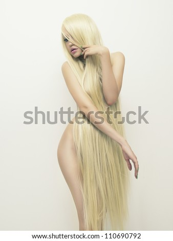Photo of nude beautiful lady with magnificent long blond hair - stock photo