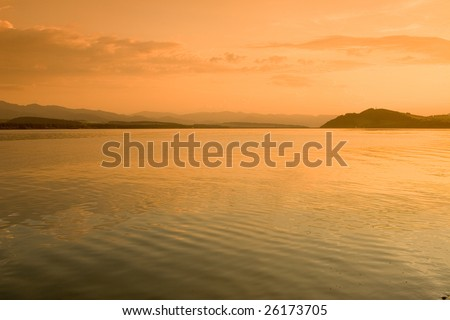 Photo of orange sunset at the seaside