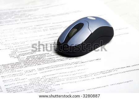Photo of pages with web code & mouse - stock photo