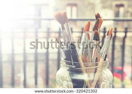 Photo of paint brushes in a jar - stock photo