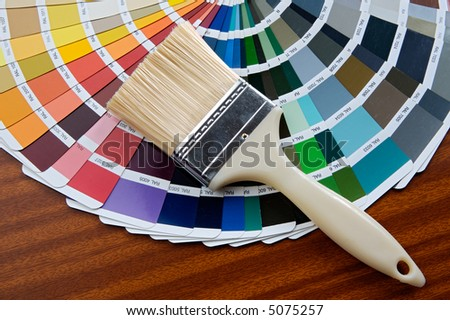 photo of Paintbrush with card of colors