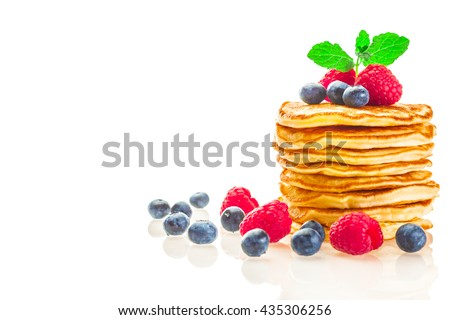 Photo of pancakes with berries over white isolated background