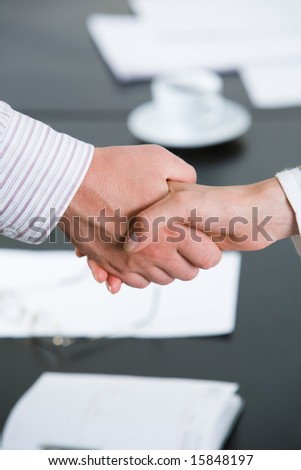 Photo of partnersâ?? hands making agreement by handshaking