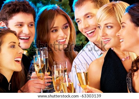 Photo of people clinking by glasses with each other - stock photo
