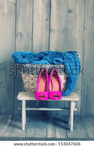 Photo of pink shoes and blue scarf - stock photo