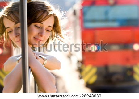 Photo of pretty passenger looking out of train window with wagon near by - stock photo