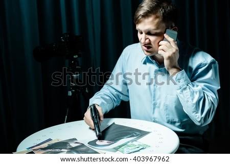 Photo of psycho killer calling his victim - stock photo