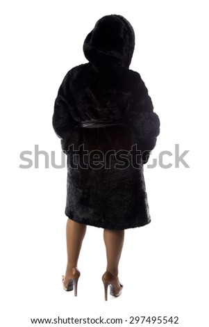 Photo of pudgy brunette in black coat, from back on white background