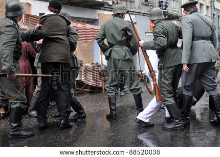 Photo of reconstruction of event taking place in time of World War II - stock photo