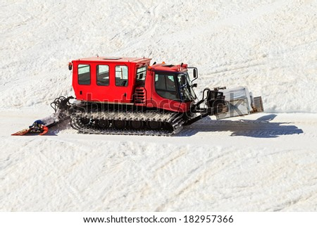 Photo of red snowcat transport food in the mountains - stock photo