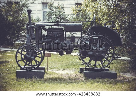 photo of rusty obsolete vintage tractor, vintage background - stock photo