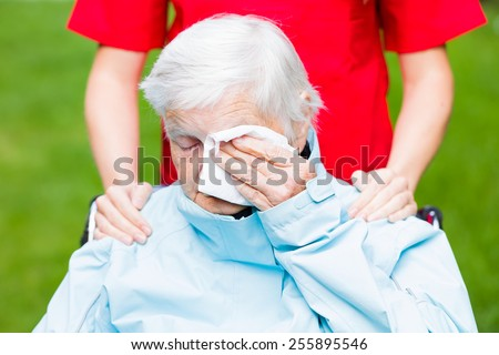 Photo of sad elderly woman who is crying - stock photo