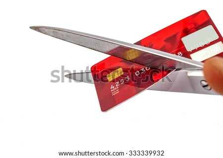 photo of scissors cutting old credit card on white background, SOFT FOCUS - stock photo
