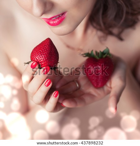 Photo of seductive female eating strawberry, closeup portrait of redhead sensual woman biting juicy fruit , fruity diet, tasty dessert, Valentine day, pleasure concept
