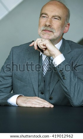 Photo of senior employer thinking about something  - stock photo