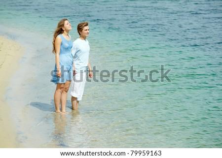 Photo of serene couple in water enjoying summer vacation - stock photo