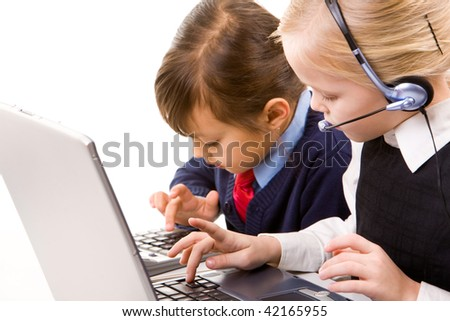 Photo of serious girl with headset typing while the other one pushing calculator buttons