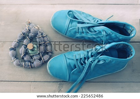 Photo of shoes on wooden background - stock photo