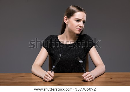 Photo of sick female with anorexia starving - stock photo