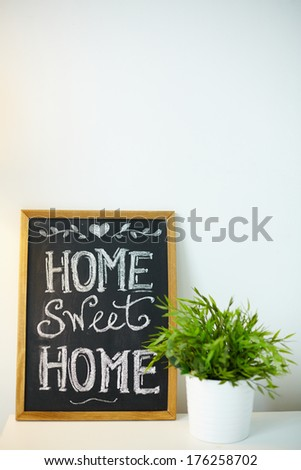 Photo of small board with message about home - stock photo