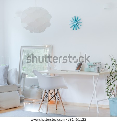 Photo of small wooden desk and stylish white chair - stock photo