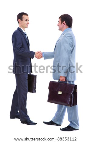 Photo of smart businessmen with briefcases handshaking on white background - stock photo