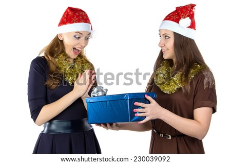 Photo of smiling women with the gift on white background
