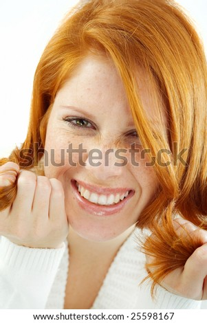 Photo of smiling young girl with red hair and freckled skin on her face - stock photo