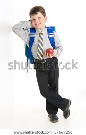 Photo of smiling youngster his elbowing against wall - stock photo