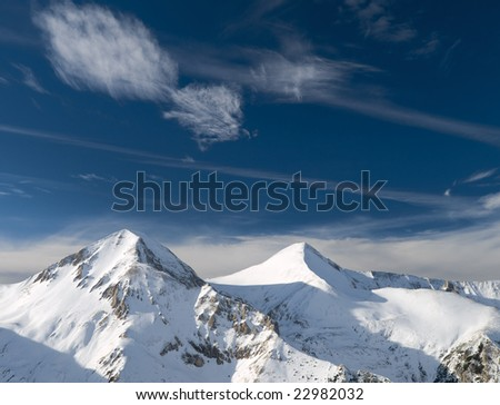 Photo of snowy mountains in the Pirin mountain in Bulgaria.